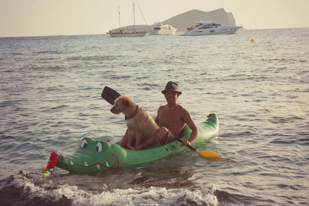 Photo of man and dog kayaking in Ibiza