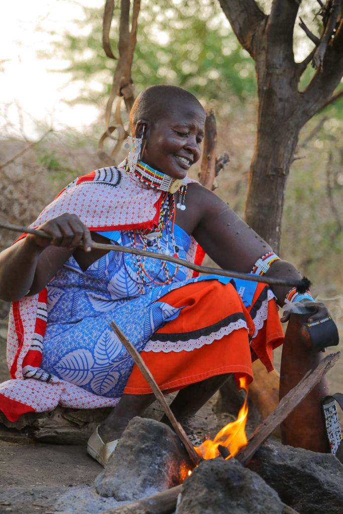 Maasai woman warming milk - Mar Gone Wild